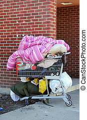 Homelessness - A shopping cart filled with a homeless...