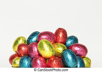 Colored Easter eggs in closeup - Colored chocolate Easter...