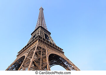 Eiffel tower close-up against blue sky, Paris, France.