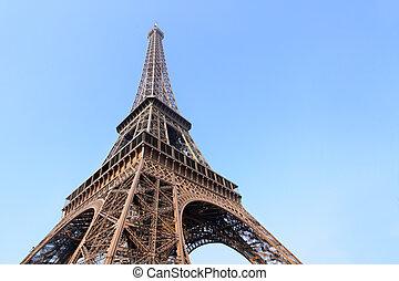 Eiffel tower close-up against blue sky, Paris, France.