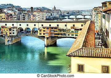 Florence - Bridge Ponte Vecchio on Arno river in Florence,...