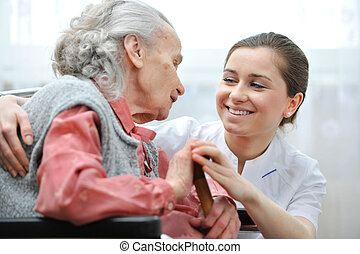 Nursing home - Senior woman with her caregiver at home