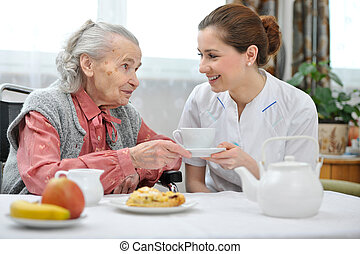 Nursing home - Senior woman eats lunch at retirement home