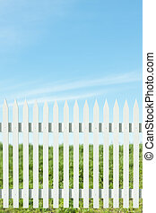 White picket fence - Newly painted white picket fence on a...