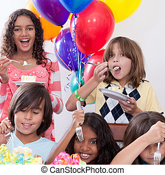 Birhtday Cake - Five multi-ethnic kids eating cake at a...