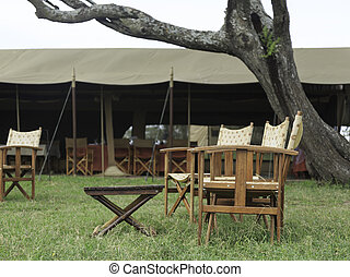 Tented accommodation at a game lodge camp with portable...