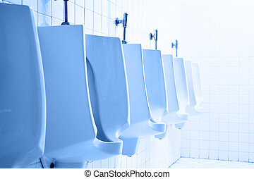 Mens public toilet with urninals blue toned