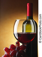 Stil-life with red wine and black grapes