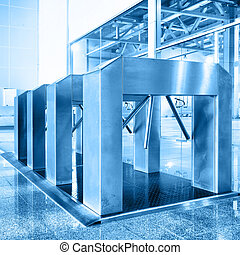 Entrance with turnstile toned in blue color