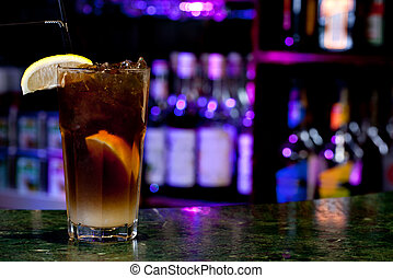 Long Island Iced Tea on the background of the bar