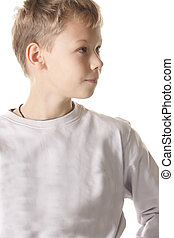 Boy looking side - Boy in gray shirt looking side closeup...