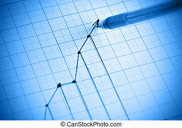 Graph - Pen drawing profit line graph. Shallow DOF!