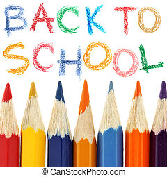 Back to school - Crayons and back to school text over white...
