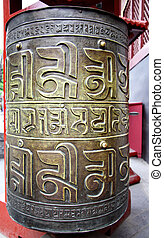Buddhist prayer wheel close-up in a temple