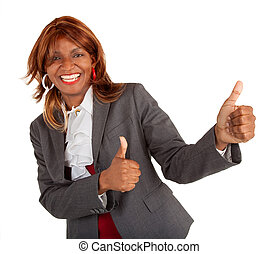 Two Thumbs Up - An African American businesswoman is showing...