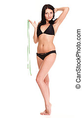 brunette girl bikini measuring waistline tape - young...