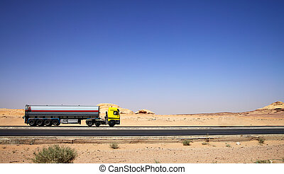 Tanker truck - Large tanker truck drive on highway at desert...