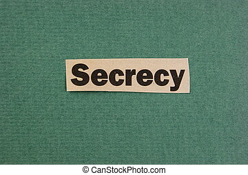 word secrecy cut from newspaper on green background