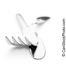 Silver cutlery equipment fork and knife on a white...
