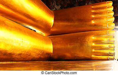 Foots of Lying Golden Buddha in Wat Pho temple, Bangkok,...