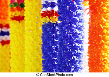 Colorful flower garlands at Buddhist temple. Thailand