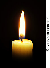 Candle - Single burning burning candle over a black...