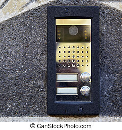 On-door speakerphone with camera on the wall