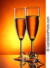 Holiday champagne - Two glasses of champagne and gold...