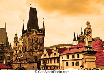 Prague - Charles bridge statues and cityscape of Prague,...