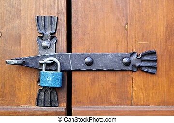 Padlock close-up on a old wooden door