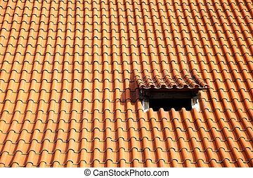 Tiled roof - Old red tiled roof with small window