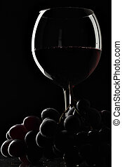 Wine and grapes - Still-life with glass of red wine and...