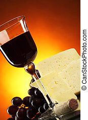 Cheese and red wine - Still-life with grapes, cheese and red...