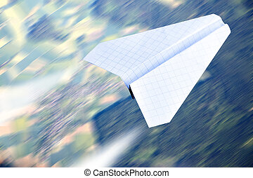 Paper plane flying - Aerial view in motion blur and paper...