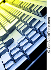 PC keyboard - Computer keyboard close up in colorful light