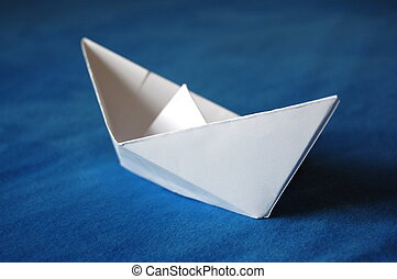 paper boat - origami paper boat isolated on blue water