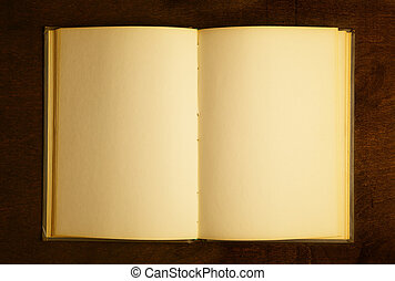Book - Opened book with blank pages on wooden table