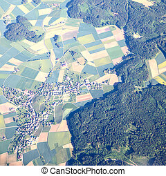 Town - Aerial view of small town near forest