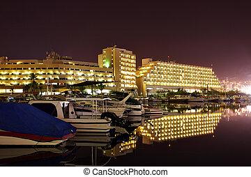Eilat at night - Hotels and yachts at night. Eilat. Israel.