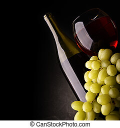Red wine and grapes - Still-life with bunch of grapes and...