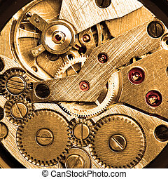 Clockwork of wristwatch macro sepia toned