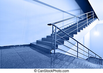Up or down? - Wide angle shot of stairs toned ib blue color
