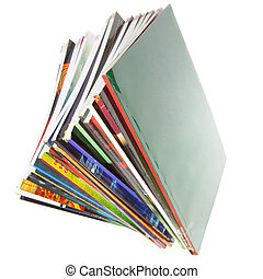 Magazines - Pile of colorful magazines isolated over white...