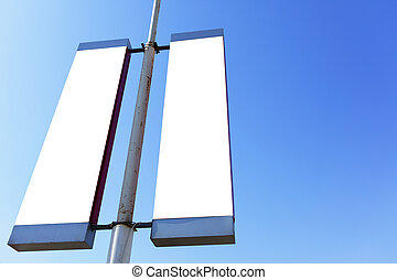 Blank signs on the post - Two blank signs on the post, put...