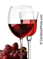 Two glasses of red wine and grapes isolated over white...