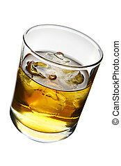 Whiskey - Glass of whiskey with ice isolated over white...