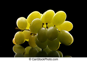 Grapes - Bunch of grapes close up over black background