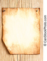 Old paper attached to wooden wall, may be used as background