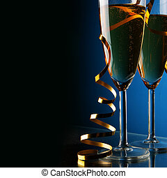 Champagne - Two glasses of champagne with space for your own...