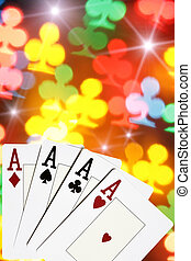 Casino - Four aces close-up over colorful clubs background